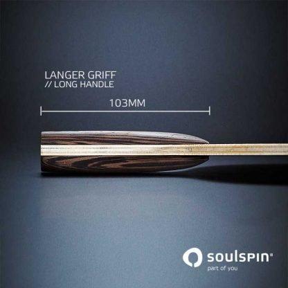 Der lange Schlägergriff am Tischtennisholz Roots 6 mit Basalt-Faser